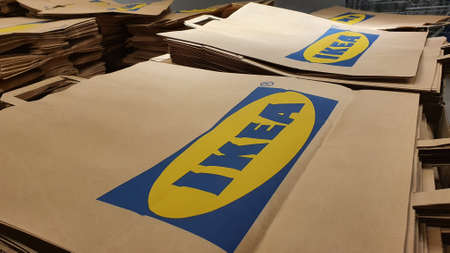 Piles of disposable Ikea brown paper bags for shoppers to use as a sustainable alternative to plastic bags