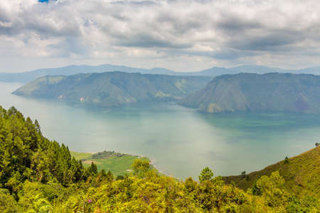 View into the crater of the largest volcanic crater lake in the world, Lake Toba, from Samosir Island, North Sumatra, Indonesia Stock Photo