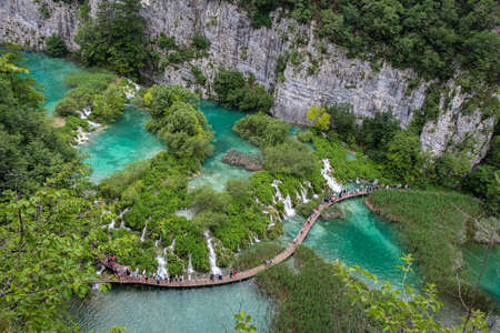 A series of waterfalls and tourists at Plitvice Lakes