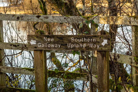 Old wooden countryside sign showing directions to New Galloway and the Southern Upland Way, Dalry, Galloway, Scotland