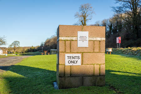 Tents only sign on a wall at a campsite in Scotland