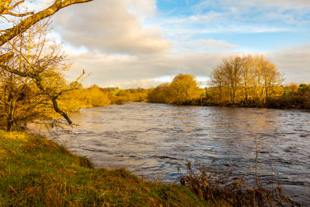 The Water of Ken between St. John's town of Dalry and New Galloway in the winter sun, Dumfries and Galloway, Scotland
