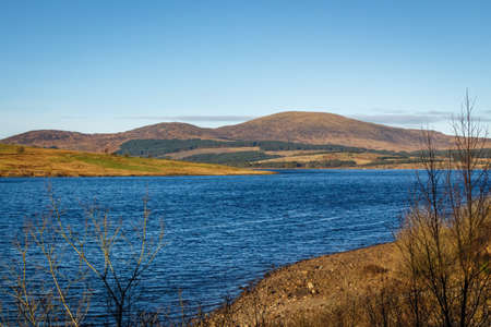Clatteringshaws Loch on a sunny winters day, in Southern Scotland.