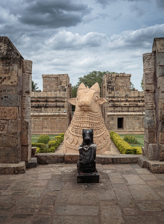 god's cow: Huge Nandi the bull at the entrance of Shiva temple Stock Photo