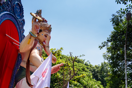 immersion: Mumbai, Maharashtra, INDIA - SEPTEMBER 27. Ganesha idol in street procession for immersion in the sea on 10th day after Ganesh Chathurthi September 27, 2015 in Mumbai,India.