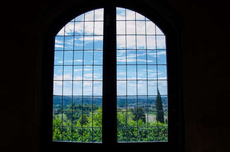 Landscape view from an old window in an ancient house.