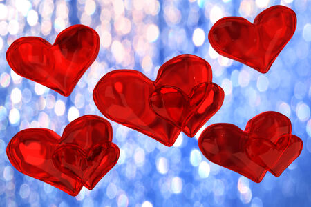 several red hearts on the background blue bokeh photo