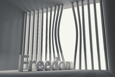 barred: bent prison bars and the inscription freedom Stock Photo