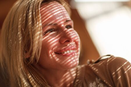 woman shadow: Portrait of young beautiful woman with striped shadow on face.