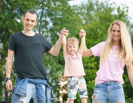 ourdoor: happy young couple lift up their son Stock Photo