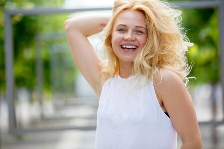 womanlike: Cheerful woman in park laughing and enjoying life