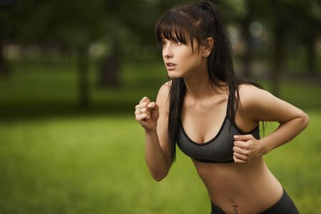 Running sports young brunette woman, portrait outdoor Stock Photo