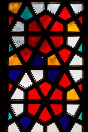 Abstract colored mosaic stained glass vertical window