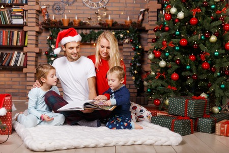 fireplace family: Happy family on soft carpet at New Years fireplace