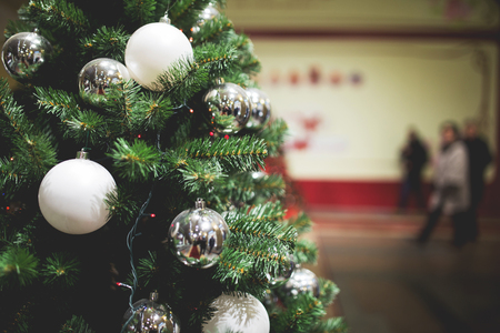 Toned photo Christmas tree with balls in store Stock Photo