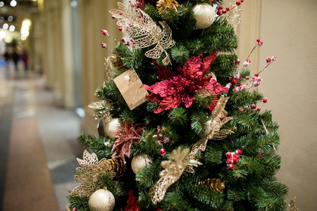 christmastide: Decorated Christmas tree in new year in trading hall Stock Photo