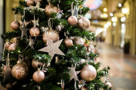 christmastide: Christmas pine tree with purple stars and balls in trading hall Stock Photo