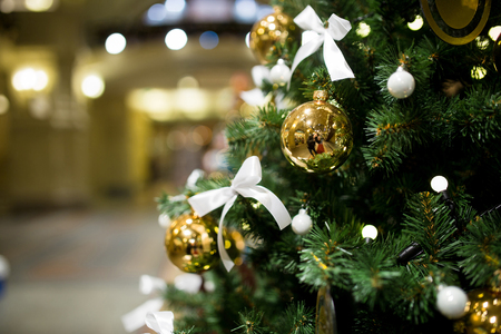 christmastide: Christmas pine tree close-up on background of shopping center Stock Photo