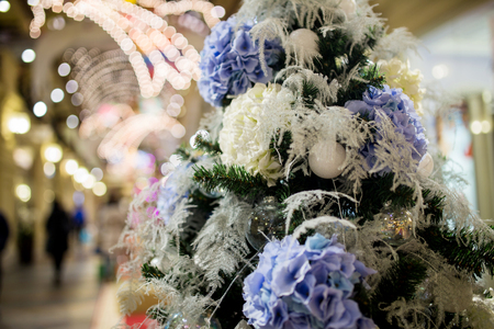christmastide: Christmas tree decorated with purple and white flowers