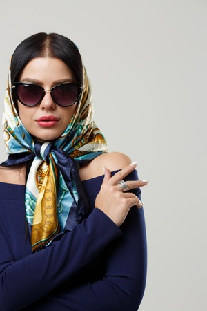 Girl in sunglasses and headscarf Stock Photo