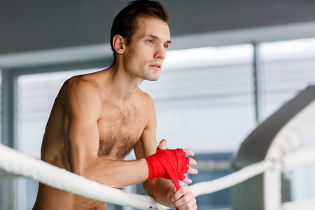 compression  ring: Young sportsman in boxing ring