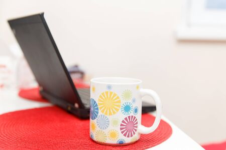 Table with laptop and cup