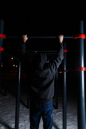 and the horizontal man: Man on metal horizontal bar