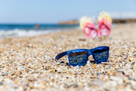 Sun glasses and beach shoes