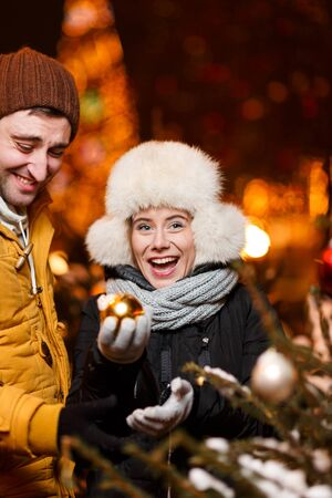 decorated tree: Beautiful couple at decorated tree