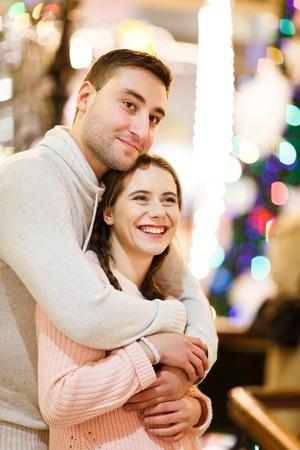 Happy man with awoman cuddling
