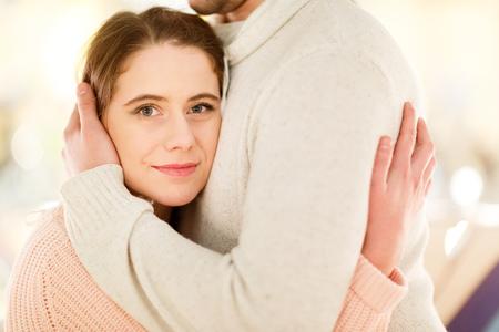 Nice man and woman hugging