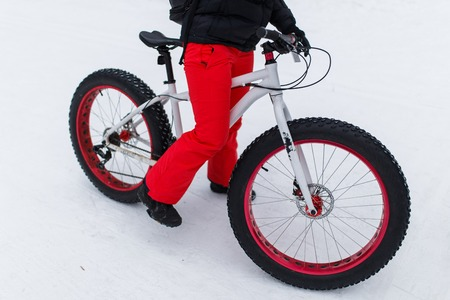Woman on bicycle at winter