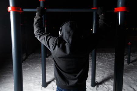 and the horizontal man: Athletic man at horizontal bar Stock Photo