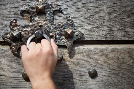 Door knocker on wooden door