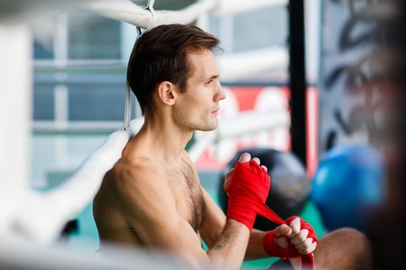 Young athlete in boxing ring Stock Photo