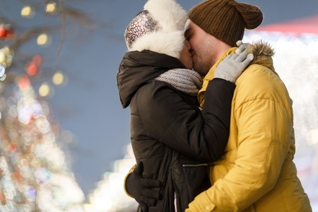 couple winter: Couple kissing outdoors on winter
