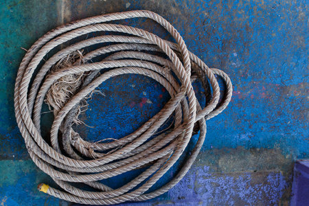 fixed line: Rope on blue wooden surface