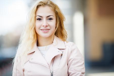 Cute blonde on defocused background
