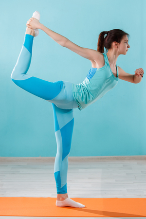 sportwoman: Young sportwoman doing yoga exercises Stock Photo