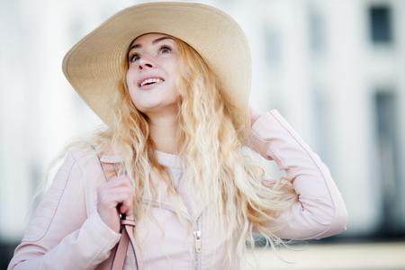 Girl in hat on street Stock Photo