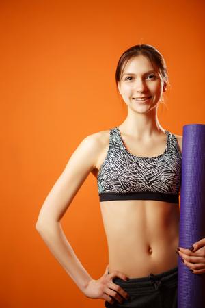 Sportswoman in sportswear with rug Stock Photo