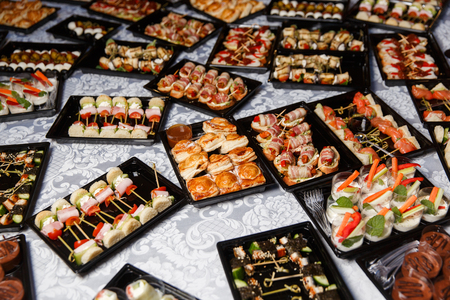 Buffet table with different snacks Stock Photo