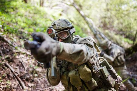 Photo of aiming military man