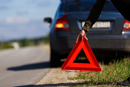 Red warning triangle on road Stock Photo