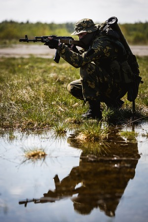 Photo of man with gun Stock Photo