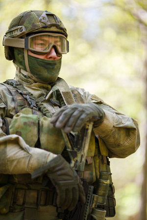 Photo of man in camouflage