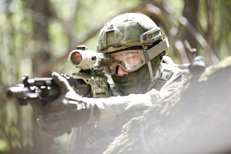 Soldier with airsoft automatic rifle