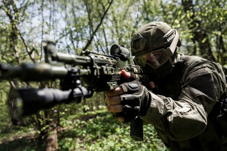 sniper training: Soldier with aiming submachine gun