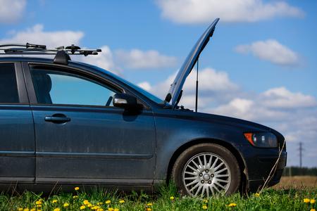 Broken car with open hood