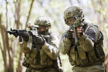 Men with weapons on reconnaissance